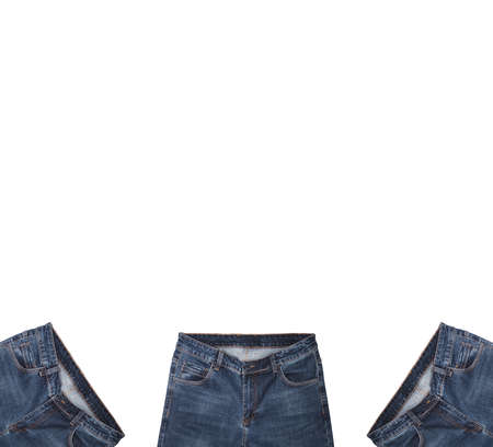 Front pockets, waist areas, zippers, and buttons of three pairs of dark blue jeans isolated on white background. Close up shot. Copy space above jeans. Portrait, vertical size. Clothing concept.