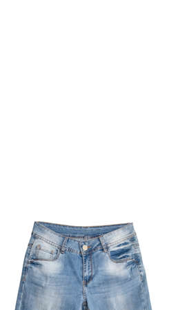 Upper part of light blue jeans isolated on white background. Faded white spots on the waist and legs area. Vertical banner size. Copy space above the jeans. Clothing, online store concepts.