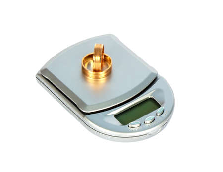 scale and wedding rings, isolated on a white background Standard-Bild