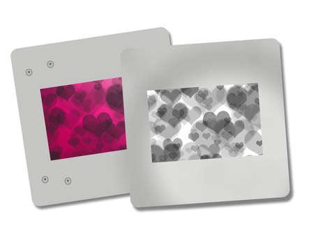 2 silver photo heart frames on a white background Standard-Bild