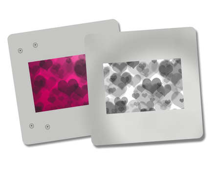 2 silver photo heart frames on a white background photo