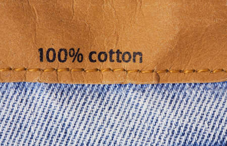 Label on jeans tissue telling  100  cotton   photo