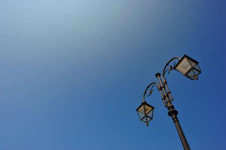 Old style street light in the sky photo