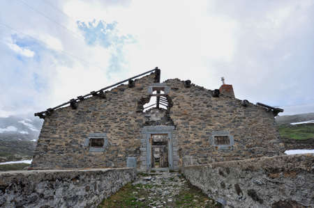 loophole: Rests of military barracks in mountain over the col du Mont Cenis Stock Photo