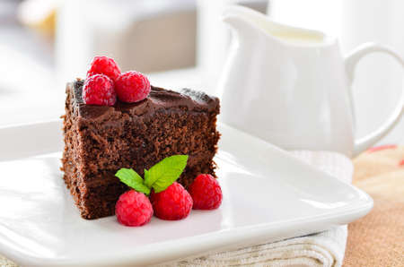 gateau chocolat: Home made chocolate cake and raspberries