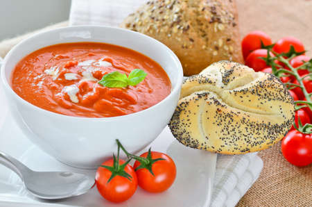 Tomato soup with crusty bread rolls