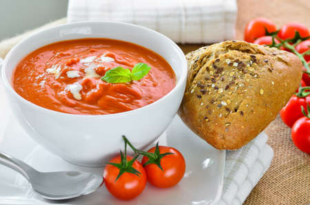 crusty: Tomato soup with crusty bread rolls