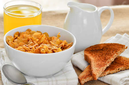 Breakfast cereal with toast and orange juice