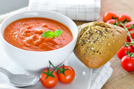 bread rolls: Tomato soup and crusty bread rolls Stock Photo