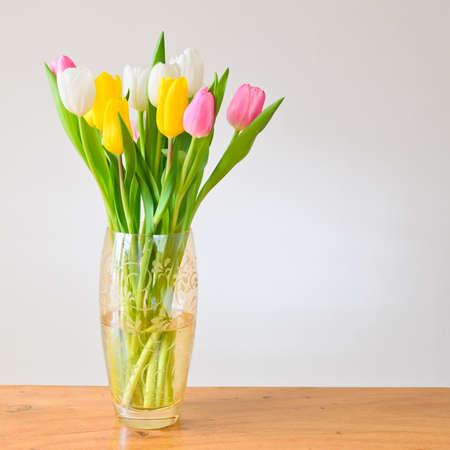 tulips in vase: Spring tulips in a vase