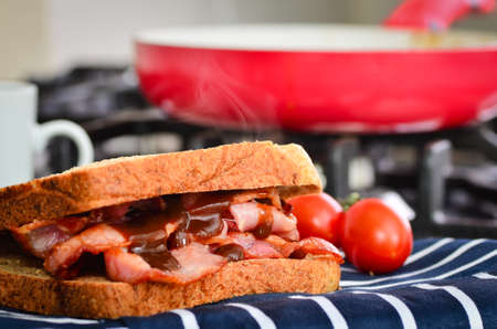 Bacon sandwich with lashings of brown sauce Stock Photo