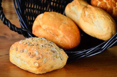crusty: Fresh crusty bread rolls in a wicker basket Stock Photo