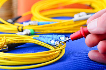 optic fiber: Network engineer testing fiber optic cables and connections