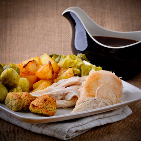 Chicken Sunday lunch with gravy boat Stock Photo