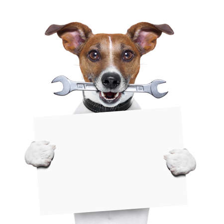 craftsman dog with spanner wrench in mouth holding a blank banner photo