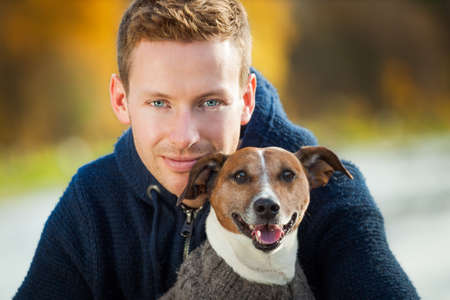 dog owner in love with his cute dog photo