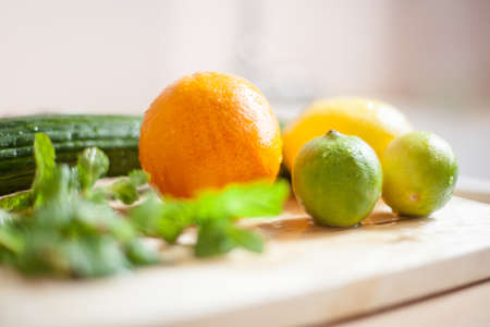 fresh vegetables on wooden kitchen table near the window light Stock Photo