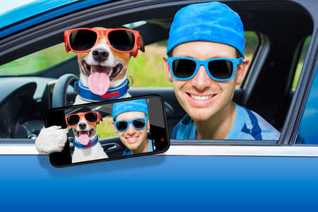 dog in a car looking through window with Driving instructor taking a selfie photo