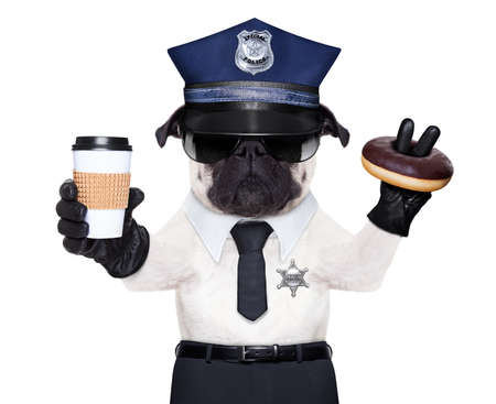 POLICE DOG ON DUTY WITH coffee to go and a donut or Doughnut photo
