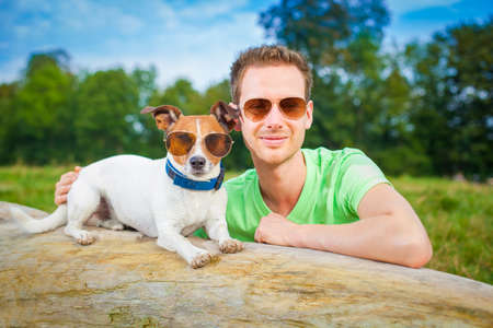dog and owner  together , very close  having a good time outdoors photo