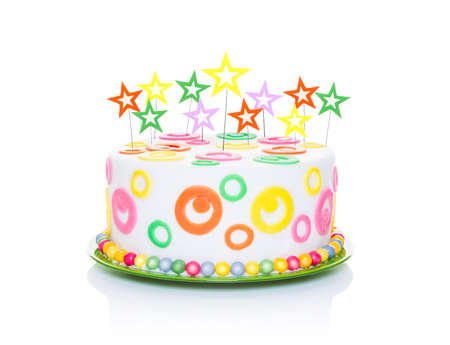 treat: happy birthday cake or tart with star candles very colorful and looking very tasty, isolated on white background
