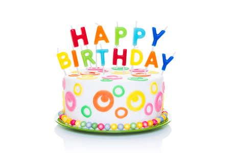 happy birthday cake or tart with happy birthday letters as candles very colorful and looking very tasty, isolated on white background Archivio Fotografico