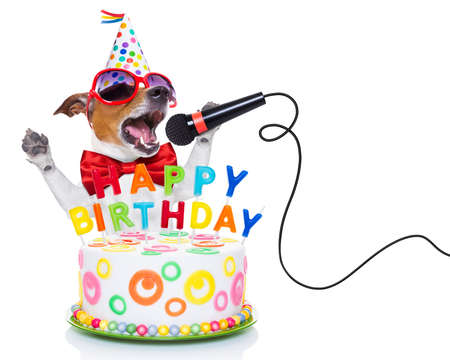 white dog: jack russell dog  as a surprise, singing birthday song  like karaoke with microphone ,behind funny cake,  wearing  red tie and party hat  , isolated on white background