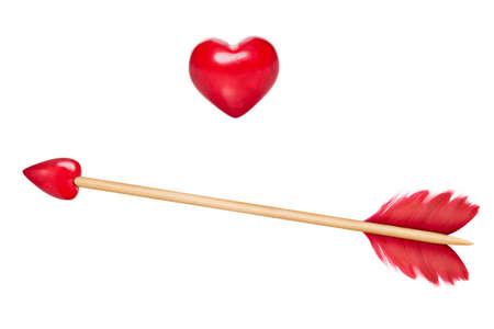 dating icons: Cupid arrow with red feathers and arrow in shape of a red heart, stick made of wood ,wooden heart also included for design purposes Stock Photo
