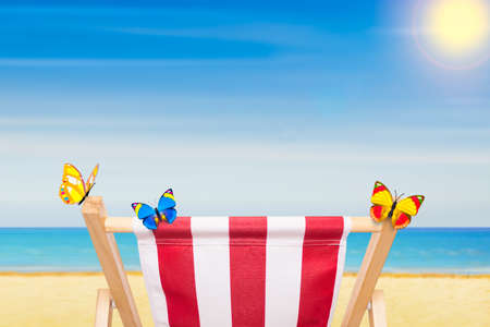 beach chair or hammock at the beach  on summer vacation holidays, ocean shore as background Stock Photo