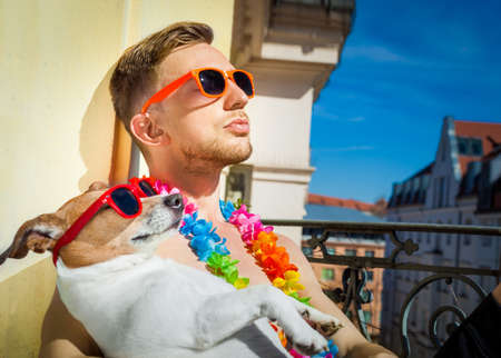 jack russell dog and owner having a siesta under the sun ,sun tanning with sunglasses, close and cozy together in love