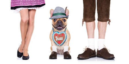 beerfest: french bulldog  dog with  gingerbread heart and bavarian couple of family owners , isolated on white background