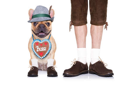 beerfest: french bulldog  dog with  gingerbread heart and bavarian owner , isolated on white background