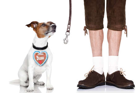 beerfest: jack russell dog with leather leash ,gingerbread heart and  bavarian owner , isolated on white background Stock Photo