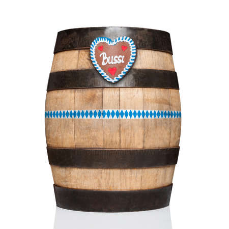 bavarian german beer barrel with  gingerbread heart,   isolated on white background , ready for the beer celebration festival in munich