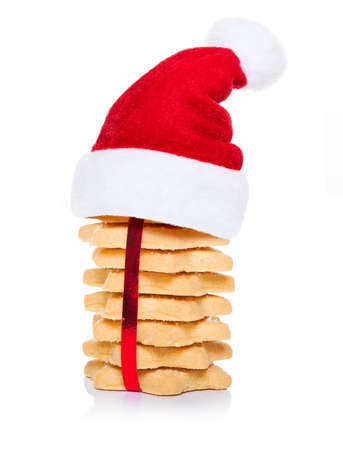 christmas backgrounds: christmas cookies biscuits with santa claus hat, isolated on white background
