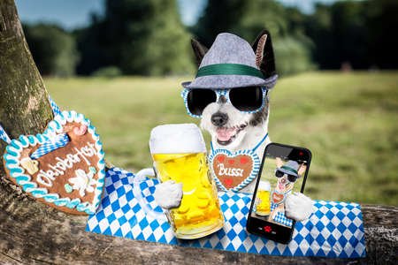 bavarian poodle  dog taking a selfie holding  a beer mug  outdoors by the river and mountains  , ready for the beer party celebration festival in munich