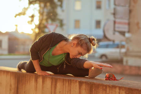 Young attractive woman practicing yoga, Splits exercise, working out.