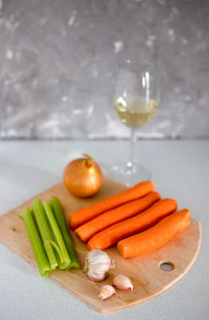 Ingredients for Bolognese sauce with a wine glass of white wine Фото со стока - 134538910