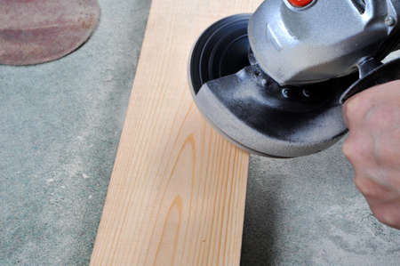 Grinding wood in carpentry shop  An angle grinder  photo