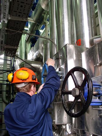 chemical engineering: pipelines and engineer, factory Stock Photo