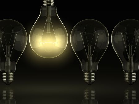 Yellow shine of bulb, idea Standard-Bild