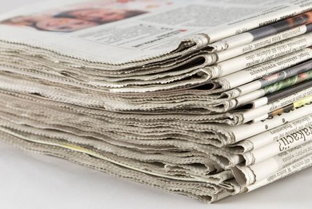 newspaper stack on white background Stock Photo - 3019786