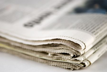 newspaper stack on white background Stock Photo - 3019779