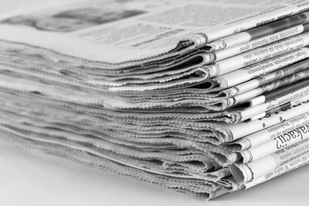 financial newspaper: newspaper stack on white background