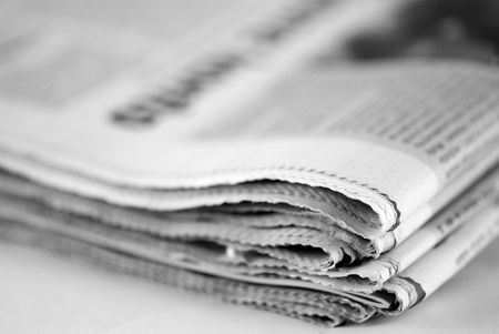 newspaper stack on white background photo