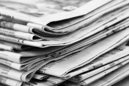 financial newspaper: newspaper stack Stock Photo