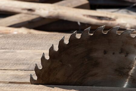 Saw blade and wood background Stock Photo - 4834920