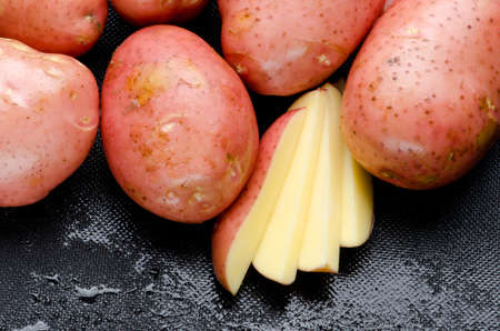 spud: Raw potatoes and potato slices