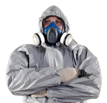 protective suit: A pest control worker wearing a mask help exterminate rats and other vermin