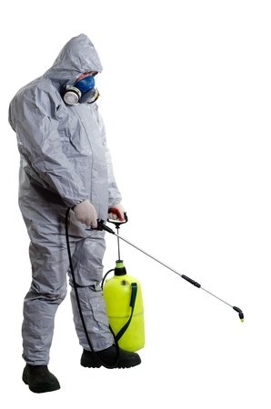 disease control: A pest control worker wearing a mask to help exterminate rats and other vermin  Stock Photo
